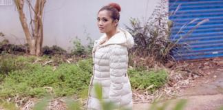 Woman wearing white down jacket