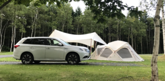 White car and white tent