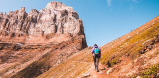 Man with backpack walking on a rocky mountain