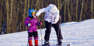 Kid and adult skiing
