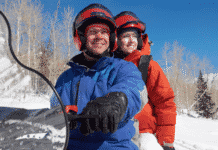 Couple Sitting on Snowmobile