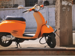 yellow moped in city