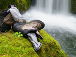 Hiker high boots and sweaty grey socks.