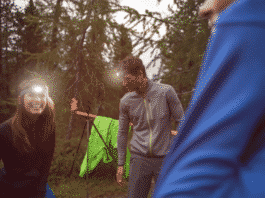 Young people hiking with headlamp