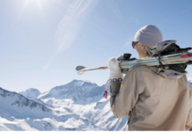 woman with skis on top of mountain